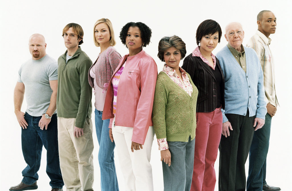 Studio Shot of a Mixed Age, Multiethnic Group of Assertive Men and Women Standing in a V Shape