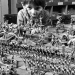 Boy with toy soldiers, January 1972